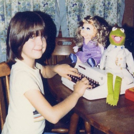 Young girl with typewriter and muppets