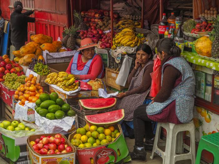 Three women in a market in La Paz, Bolivia