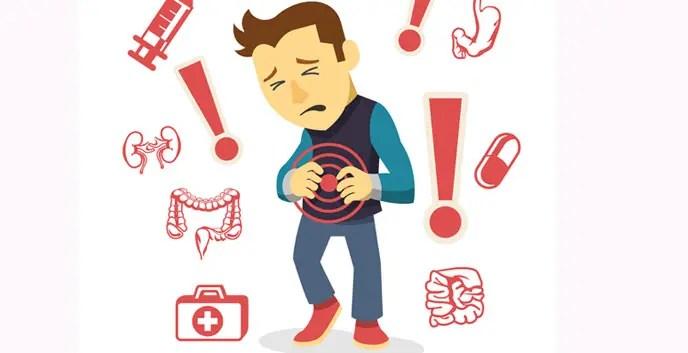uomo confuso tra medicine e parti dell'apparato digestivo dolenti