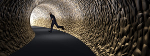 Concept 3D business man, dark road tunnel with bright light at t
