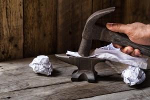 hammer flattens paper mistake