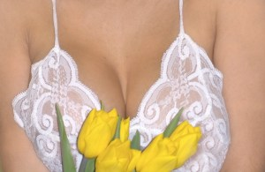 cleavage and tulips to illustrate explicit sex