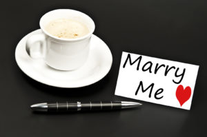 marry me note left with cup of coffee