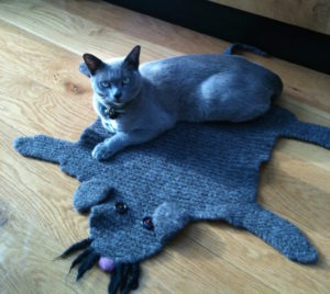 blue Burmese cat on blue cat rug
