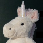 head of toy unicorn with no visible eyelashes