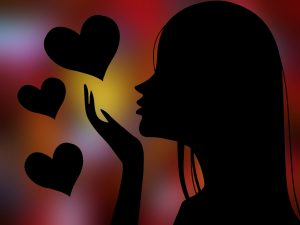 silhouette of girl with hearts