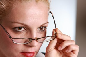 stern woman with glasses halfway down nose