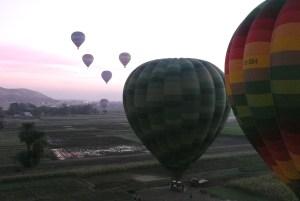 Hot air balloons above the Nile at dawn