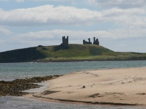 Dunstanburgh Castle, sea and sand