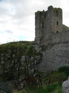 Dunstanburgh Castle's sheer drop to the sea