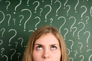 woman against background of question marks