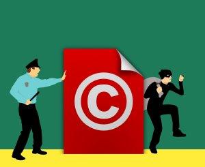 policeman defends copyright against thief cartoon