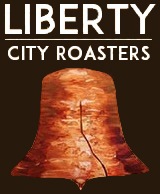 White text that says Liberty City Roasters above a painted Liberty Bell