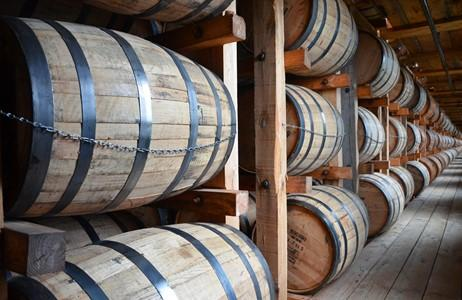 Picture of Barrels of whiskey in a distillery to show the physical assets tokenized as a whiskey fund.