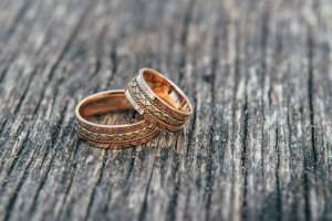 two golden rings on wooden surface