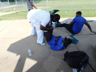 Coach Cooper stretching Paul Selman