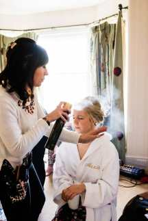 Bride having her hair and makeup done at the King John Inn
