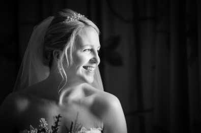Bride looking out the window during her Larmertree wedding