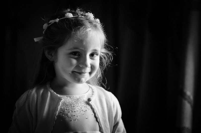 Cute flowergirl at Larmertree gardens in wiltshire