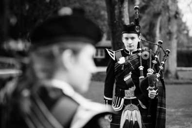 Bagpiper stands to attention