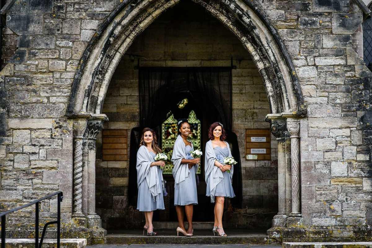 Bridesmaids wait for bride at St Edwards Church