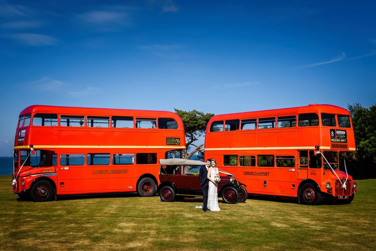 Routemaster buses at Studland bay house wedding