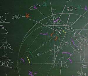 math drawings on chalkboard