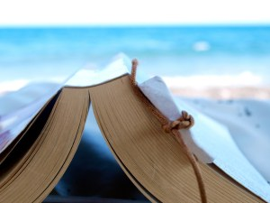 Reading a book at the beach by Simon on Flickr