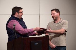 Alan Lutton receiving advocacy award plaque