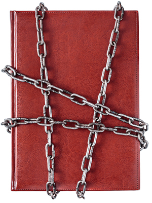 Red book with crisscrossed chains binding it