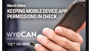 Hand holding cell phone with text about video
