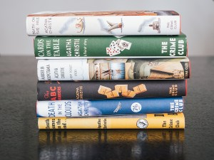 Stack of Various Detective or Crime Novels by Agatha Christie, a Pile of Fiction Books with Vintage Covers.