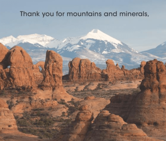 A page from Thank You, Earth is featured in this image to engage readers in the lesson activity. Snowcapped mountains in the background and red clay rocks in the foreground.