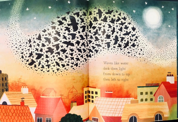 "A flock of birds swirl together in the sky above a cityscape in this double page spread of the book ""One Dark Bird""."