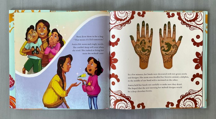 Two pages of the book Amira's Picture Day by Reem Faruqi and Fahmida Azim. The pages show hands decorated with mehndi designs.