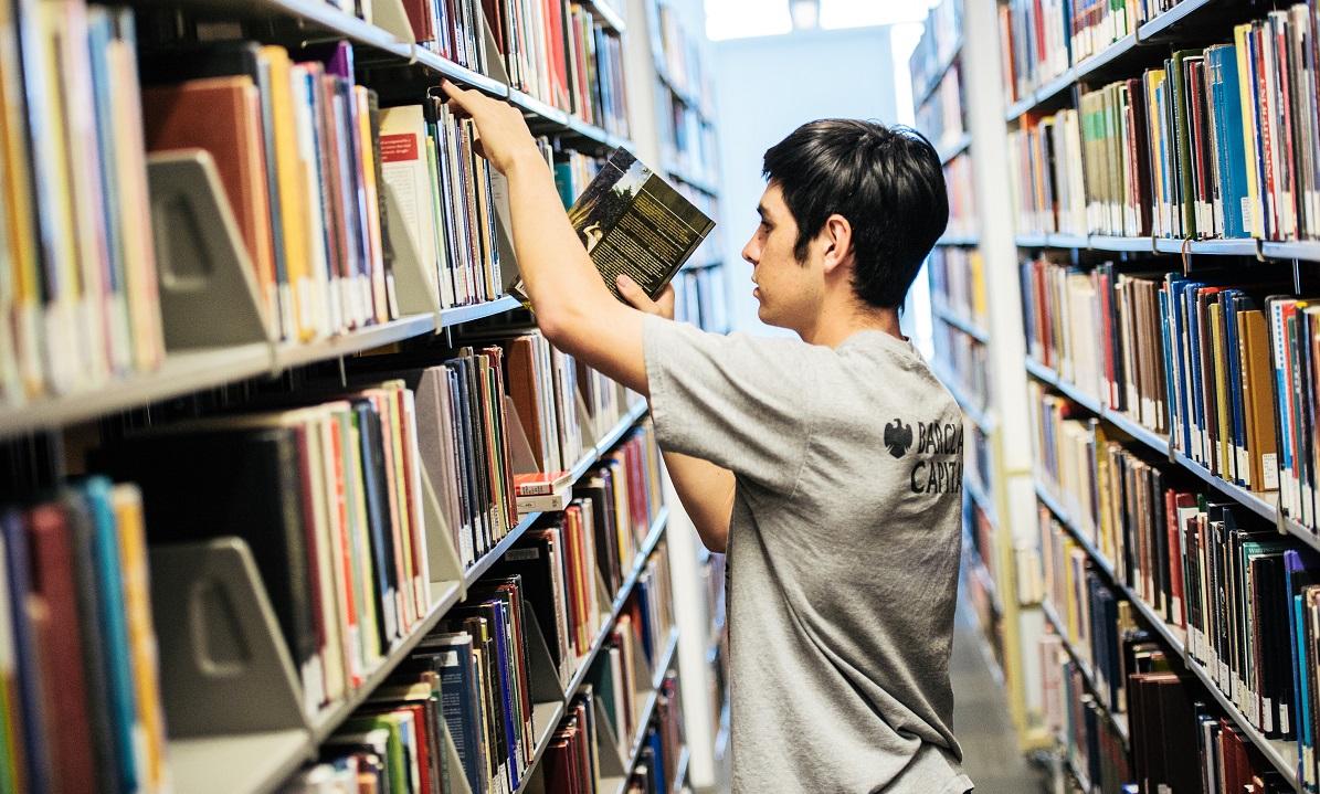 Student reshelving books