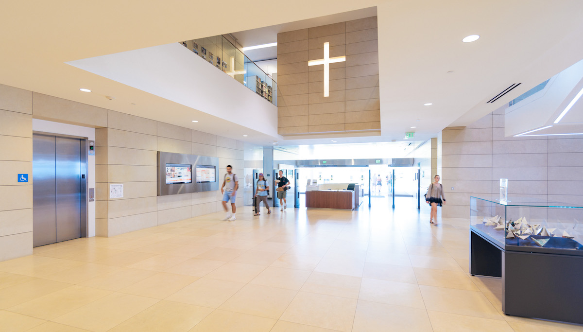 William H. Hannon Library lobby with illuminated cross