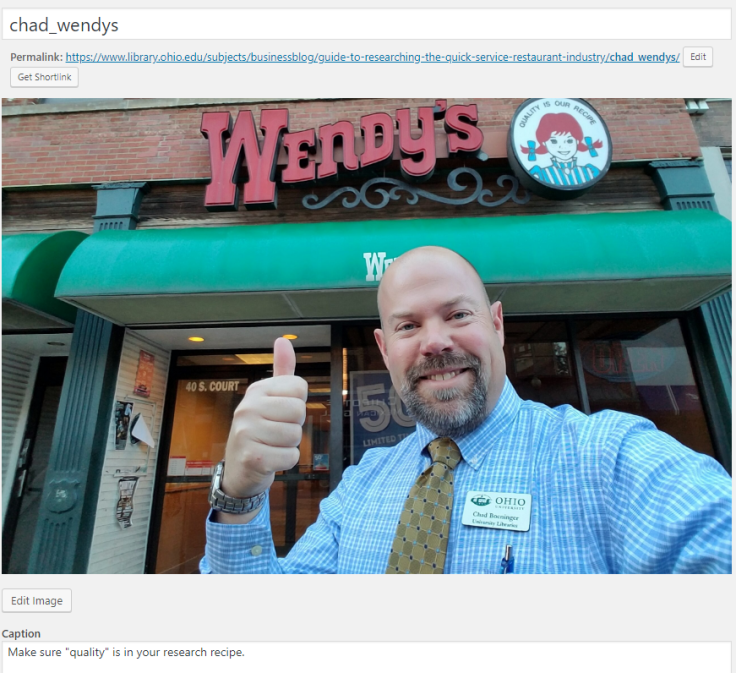 a picture of Chad in front of Wendy's