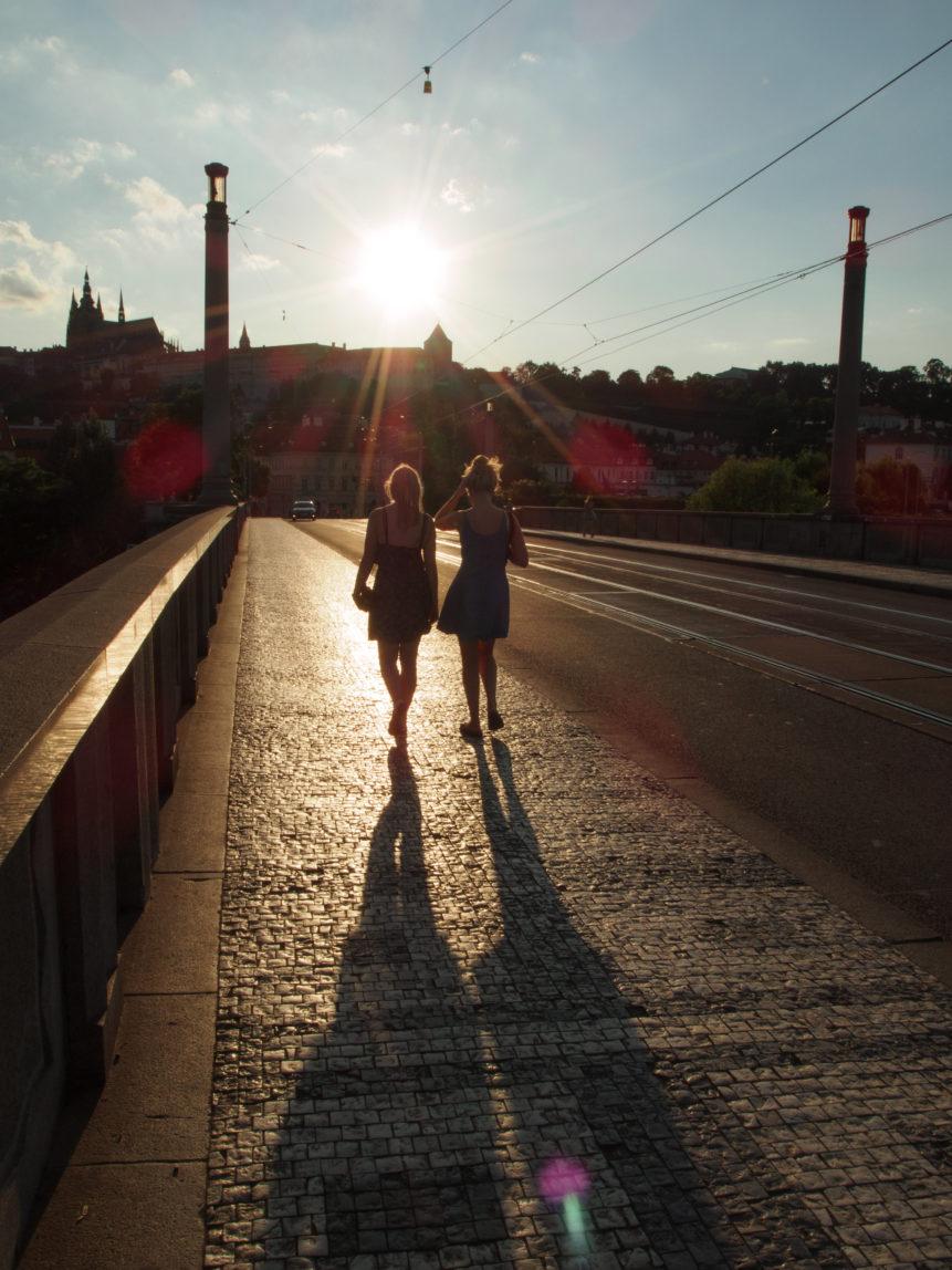 Two Tourists Girls Walking On The Prague Bridge Free