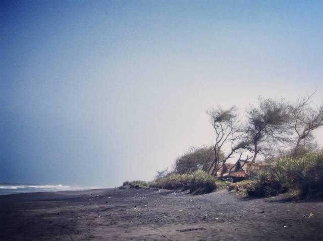 Vacation on Pandansimo Beach, Seeing Fisherman's Village with a Windmill Power Plant. via IG @rettasimson