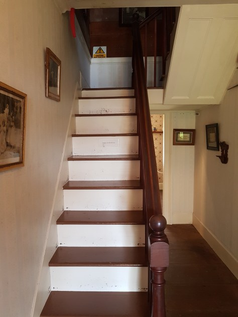 Leading up to the kids bedroom and the school room