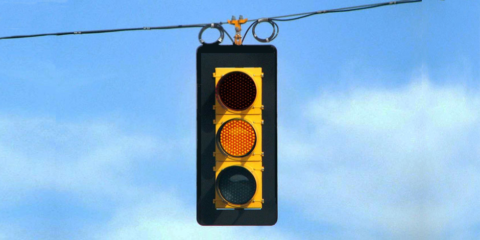 traffic signal with steady yellow light