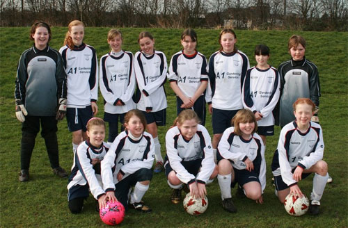 Lichfield Diamonds U12 showing off their new kit, sponsored by A1 Gardening services