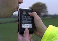 A breath test being carried out