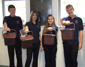 Sam Heele, Emily Baggott, Katie Jordan, and Oliver Tooth with recycling caddies