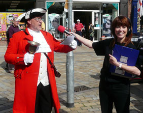 Joanne Malin interviews the town crier during her show