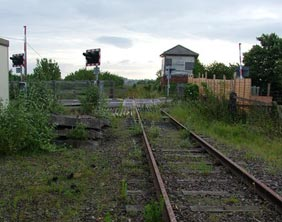 An overgrown crossing on the former Lichfield to Walsall railway line. Pic: Dawntreader