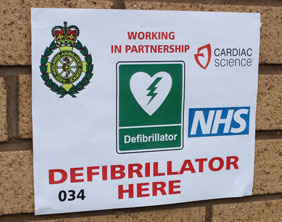 One of the new defibrillator signs