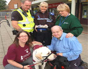PC Dave Fletcher and PCSO Hilary Gittins with Edward Blacksmith and representatives from Hearing Dogs for Deaf People