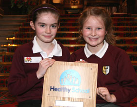 SS Peter & St Paul Catholic Primary School students Pippa Peet and Victoria Pickering with the award